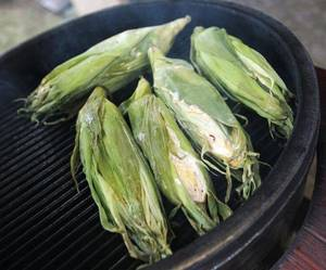 Photo - Corn cooks on a grill during a cooking event at American Propane, 7401 Broadway Extension. Photo by Nate Billings, The Oklahoman <strong>NATE BILLINGS</strong>