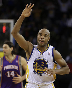 Photo - Golden State Warriors' Jarrett Jack celebrates his score against the Phoenix Suns during the second half of an NBA basketball game Wednesday, Feb. 20, 2013, in Oakland, Calif. (AP Photo/Ben Margot)