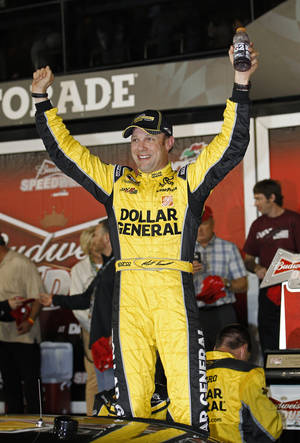 Photo - Matt Kenseth celebrates in Victory Lane after winning the first of two NASCAR Sprint Cup series qualifying auto races at Daytona International Speedway in Daytona Beach, Fla., Thursday, Feb. 20, 2014. (AP Photo/Terry Renna)
