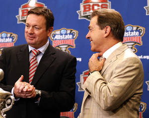 Photo - Oklahoma head coach Bob Stoops and Alabama head coach Nick Saban greet each other during a press conference for the Allstate Sugar Bowl, Wednesday, Jan. 1, 2014 in New Orleans. Photo by Sarah Phipps, The Oklahoman