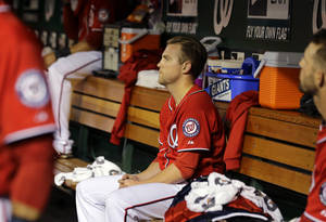 Photo - Washington Nationals relief pitcher Drew Storen (22) sits in the dugout after the eighth inning of a baseball game against the Philadelphia Phillies at Nationals Park, Saturday, May 25, 2013, in Washington. Storen gave up two runs. The Phillies won 5-3. (AP Photo/Alex Brandon)