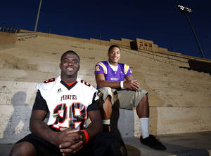 Photo - Northwest Classen's Terry Arnold and Putnam City's Desmond Tilly pose for a photo at Taft Stadium in Oklahoma City,  Thursday, Nov. 3, 2011. Photo by Sarah Phipps, The Oklahoman  ORG XMIT: KOD