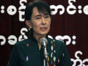 Photo -   Myanmar opposition leader Aung San Suu Kyi speaks about her trip to the United States during a press conference at the headquarters of her National League for Democracy Party in Yangon, Myanmar, Monday, Oct. 8, 2012. (AP Photo/Khin Maung Win)