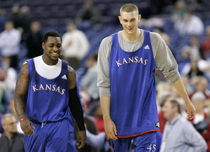 Photo - New Thunder center Cole Aldrich, right, could bring a strong defensive presence to Oklahoma City. AP PHOTO