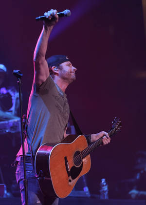 Photo - Dierks Bentley performs at the Chesapeake Energy Arena in Oklahoma City, Friday, March 8, 2013. He and tour mate Miranda Lambert, who lives in Tishomingo, will bring their ?Locked & Reloaded Tour? back to the Sooner State for an April 13 show at Tulsa's BOK Center.  Photo by Garett Fisbeck, For The Oklahoman <strong>Garett Fisbeck - FOR THE OKLAHOMAN</strong>