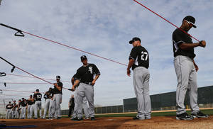 Photo - Chicago White Sox pitchers stretch during spring training baseball practice in Glendale, Ariz., Wednesday, Feb. 19, 2014. (AP Photo/Paul Sancya)