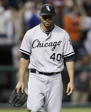 Photo - Chicago White Sox relief pitcher Ramon Troncoso walks back to the dugout after giving up a game-winning solo home run to Cleveland Indians' Jason Giambi in the ninth inning of a baseball game, Monday, July 29, 2013, in Cleveland. The Indians won 3-2. (AP Photo/Tony Dejak)