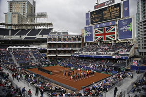 Photo - Players line the court during the pening ceremony for a Davis Cup tennis match between the United States and Great Britain, that takes place in the left field corner at Petco Park, home fo the San Diego Padres baseball team, Friday, Jan. 31, 2014, in San Diego. (AP Photo/Lenny Ignelzi)