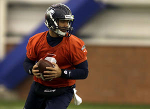 Photo - Seattle Seahawks quarterback Russell Wilson drops back during NFL football practice Thursday, Jan. 30, 2014, in East Rutherford, N.J. The Seahawks and the Denver Broncos are scheduled to play in the Super Bowl XLVIII football game Sunday, Feb. 2, 2014. (AP Photo)