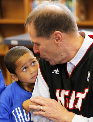Photo - Superintendent Karl Springer talks with Nathaniel Hamilton Wednesday at North Highland Elementary School. Photo by Sarah Phipps, The Oklahoman
