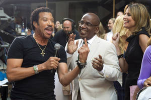 "Photo -   Lionel Richie, left, sings with Al Roker and Savannah Guthrie while performing on NBC's ""Today"" show on Thursday, Aug. 16, 2012 in New York. (Photo by Charles Sykes/Invision/AP)"