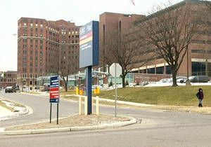 """Photo - This frame grab provided by WJRT-TV shows Hurley Medical Center in Flint, Mich. The case of a white swastika-tattooed Michigan father insisting a black nurse at the hospital not be allowed to care for his newborn child highlights one of medicine's """"open secrets"""" _ allowing patients to refuse treatment by a doctor or nurse of another race. The nurse is noiw suing the hospital, claiming it bowed to his illegal demands. (AP Photo/Courtesy WJRT-TV) MANDATORY CREDIT: WJRT"""