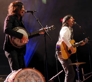 Photo - Scott Avett, left, and Seth Avett perform during a concert by the Avett Brothers at Chesapeake Energy Arena in Oklahoma City, Friday, July 27, 2012. Photo by Nate Billings, The Oklahoman