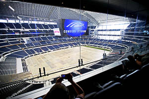 Photo - A group of media members sit in the club level as they take a tour of Cowboys Stadium in Arlington, Texas. Photo by Bryan Terry, The Oklahoman