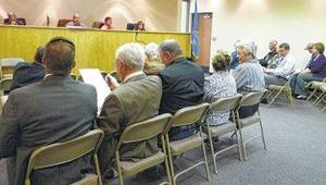 Photo - Some of those who attended a recent county commissioners' meeting and spoke for or against a wall in the Bryan County Courthouse. (Durant Daily Democrat photo)