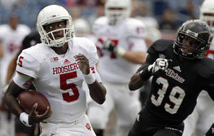 Photo -   In the midst of a long touchdown run, Indiana quarterback Tre Roberson (5) is chased by Massachusetts defensive back Mike Lee (39) during their NCAA college football game in Foxborough, Mass., Saturday, Sept. 8, 2012. (AP Photo/Stephan Savoia)