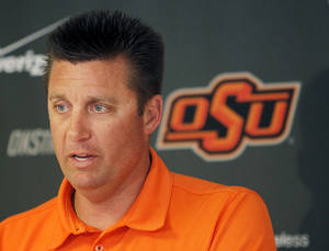 Photo - COLLEGE FOOTBALL: Head coach Mike Gundy speaks to the media during the OSU spring football press conference at Boone Pickens Stadium on the campus of Oklahoma State University in Stillwater, Okla., Monday, March 12, 2012. Photo by Nate Billings, The Oklahoman