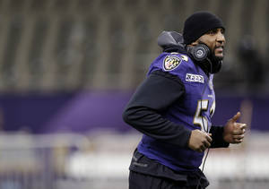photo - Baltimore Ravens linebacker Ray Lewis jogs during an NFL Super Bowl XLVII walkthrough on Saturday, Feb. 2, 2013, in the Mercedes-Benz Superdome in New Orleans. The Ravens face the San Francisco 49ers in Super Bowl XLVII on Sunday. (AP Photo/Patrick Semansky)