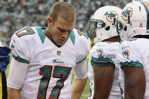 Photo -   Miami Dolphins quarterback Ryan Tannehill (17) reacts during the first half of an NFL football game against the New York Jets Sunday, Oct. 28, 2012 in East Rutherford, N.J. (AP Photo/Seth Wenig)