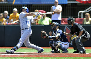 Photo - Kentucky's Thomas Bernal hits a 2-run double in the ninth inning of an NCAA college baseball regional tournament game in Louisville, Ky., Saturday, May 31, 2014. Kentucky Defeated Kent State 4-2. (AP Photo/Timothy D. Easley)