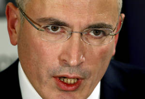 Photo - Mikhail Khodorkovsky speaks during a news conference in Berlin, Sunday, Dec. 22, 2013. The former oil baron and prominent critic of Russian President Vladimir Putin, Mikhail Khodorkovsky, was reunited with his family in Berlin on Saturday, a day after being released from a decade-long imprisonment in Russia. (AP Photo/Michael Sohn)