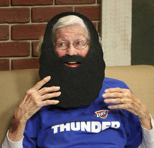 "Photo - Being 88 years old doesn't deter Guila Shell from showing her support for the OKC Thunder, whom she affectionately refers to as ""family.""  She is photographed in the offices of The Oklahoman on Thursday,  June 21, 2012.   Photo by Jim Beckel, The Oklahoman"