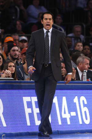 Photo - Miami Heat coach Erik Spoelstra calls to his team during the first half of an NBA basketball game against the New York Knicks on Saturday, Feb. 1, 2014, in New York. Miami won 106-91. (AP Photo/Jason DeCrow)
