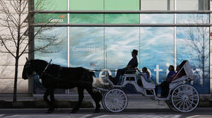 Photo -  A horse carriage heads north Saturday on Hudson in downtown Oklahoma City. Photo by Doug Hoke, The Oklahoman  <strong>DOUG HOKE</strong>