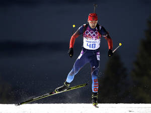 Photo - Russia's Anton Shipulin competes during the men's biathlon 10k sprint, at the 2014 Winter Olympics, Saturday, Feb. 8, 2014, in Krasnaya Polyana, Russia. (AP Photo/Felipe Dana)