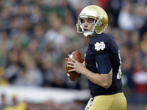 Photo -   Notre Dame quarterback Tommy Rees drops back to pass against Brigham Young during the first half of an NCAA college football game in South Bend, Ind., Saturday, Oct. 20, 2012. (AP Photo/Michael Conroy)
