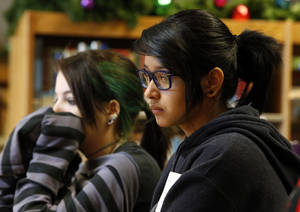 Photo - Western Heights Middle School eighth-graders Tabitha Cox and Daisy Robledo listen during a reading class as their school kicks the One Kid Challenge.  Photo by Steve Sisney, The Oklahoman <strong>STEVE SISNEY - THE OKLAHOMAN</strong>