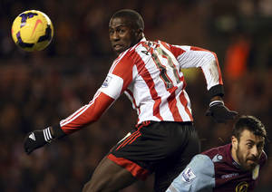 Photo - FILE - In this Jan. 1, 2014, file photo, Sunderland's Jozy Altidore, left, watches a shot toward goal past Aston Villa's Antonio Luna, right, during an English Premier League soccer match in Sunderland, England. Altidore, one of the U.S. soccer team's top goal scorers continued to struggle last weekend. Altidore, who tied for the team lead with eight goals last year in 14 appearances for the Americans, was scoreless in Saturday's 1-0 win for Sunderland in the FA Cup. The forward has scored just one goal in the English Premier League this season, (AP Photo/Scott Heppell, File)