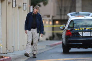 Photo - Law enforcement officers investigate the accidental fatal shooting of a Bay Area Rapid Transit police officer by a fellow BART officer while serving a warrant at an apartment building, according to officials, Tuesday, Jan. 21, 2014, in Dublin, Calif. (AP Photo/The Contra Costa Times, Dan Honda)