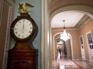 """Photo - FILE - In this Tuesday, Jan. 1, 2013, file photo, the Ohio Clock strikes midnight as the Senate continues to work on the fiscal cliff, on Capitol Hill in Washington. The deal in Congress that stopped the country from going over the """"fiscal cliff"""" removed one layer of uncertainty for small business owners who now have a sense of what their income taxes will be in 2013, but big issues still remain for them to worry about. (AP Photo/Alex Brandon, File)"""