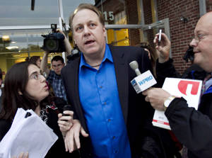 Photo -   FILE - In this May 21, 2012 file photo, former Boston Red Sox pitcher Curt Schilling, center, departs the Rhode Island Economic Development Corporation headquarters in Providence, R.I., after he met with the agency to discuss the finances of his troubled video company. The government deal that guaranteed a $75 million loan for Schilling's 36 Studios focused almost exclusively on how quickly the firm would bring jobs to Rhode Island and overlooked requirements for attracting outside investment or other steps that could have helped protect the public's money. (AP Photo/Steven Senne, File)