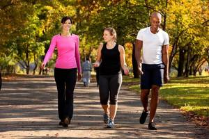 Photo - Walking for fitness is a low-impact workout that burns fat. (NewsUSA)