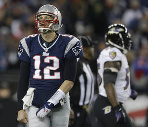 photo - New England Patriots quarterback Tom Brady looks up at the scoreboard during the second half of the NFL football AFC Championship football game against the Baltimore Ravens in Foxborough, Mass., Sunday, Jan. 20, 2013. (AP Photo/Steven Senne)