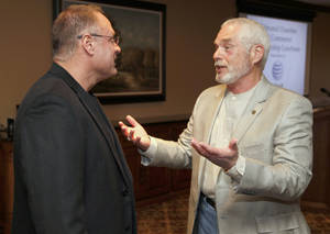 Photo -  Randy Allen, with Midcon Data Services, left, speaks with Edmond Mayor Charles Lamb before the Edmond Chamber of Commerce luncheon. PHOTO BY PAUL HELLSTERN, THE OKLAHOMAN  <strong>PAUL HELLSTERN -   </strong>