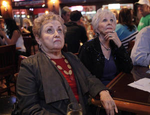 Photo - Jo S. Fudge and Marlene DuCharme watch the debates at the State Republicans Party debate watch party at the Fox and Hound on Memorial, Monday, October 22, 2012. Photo By David McDaniel/The Oklahoman