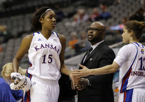 photo - Kansas' Chelsea Gardner (15) leaves the game and is greeted at the bench by a staff member and Monica Engelman (13) in the second half of an NCAA college basketball game against TCU in the Big 12 women's tournament Friday, March 8, 2013, in Dallas. Gardner had 11 points in the 83-61 Kansas win. (AP Photo/Tony Gutierrez)
