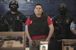 "Photo -   Jose de Jesus Mendez Vargas, aka, ""El Chango"" or ""The Monkey,"" alleged leader of Mexican La Familia drug cartel, looks on during his presentation to the press in Mexico City, Wednesday, June 22, 2011. Mendez was arrested at a federal police checkpoint in the Mexican central state of Aguascalientes Tuesday, without confrontation or casualties according to authorities. The government had offered a $2.5 million reward for his capture. (AP Photo/Miguel Tovar)"