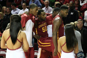 Photo - Iowa State guard DeAndre Kane is carried off the floor due to an injury following a loss to Oklahoma in an NCAA college basketball game in Norman, Okla., on Saturday, Jan. 11, 2014. Oklahoma won 87-82. (AP Photo/Alonzo Adams)