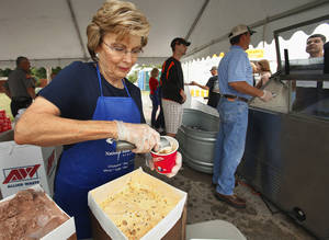 photo - Rosemary Osborn scoops up some ice cream during the Tuttle Ice Cream Festival in 2010. PHOTO BY STEVE SISNEY, THE OKLAHOMAN ARCHIVES