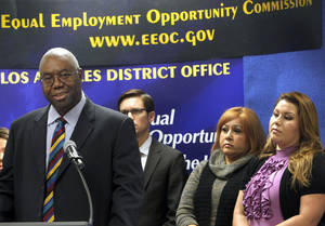 Photo - Olophius Perry, District Director, EEOC Los Angeles District Office, talks during a news conference in Los Angeles Tuesday, Dec.18, 2012. Department store chain Dillard's Inc. is paying $2 million to settle charges that it illegally required workers who took sick leave to reveal confidential medical information. The settlement, announced Tuesday by the Equal Employment Opportunity Commission, resolves a four-year-old class action lawsuit that charged Dillard's with violating the Americans with Disabilities Act. (AP Photo/Nick Ut)