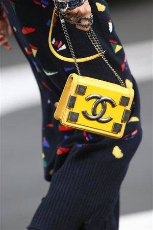Photo - A model wears a creation by German fashion designer Karl Lagerfeld for Chanel's Fall/Winter 2013-2014 ready to wear collection, in Paris, Tuesday, March, 5, 2013. (AP Photo/Thibault Camus)