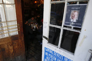 Photo - A photograph of NFL football commissioner Roger Goodell, top right, is posted on the door of the Coop's Place restaurant, Thursday, Jan. 31, 2013, in New Orleans, La. New Orleans is preparing for the NFL football Super Bowl on Sunday and several restaurants have posted signs against serving Goodell. (AP Photo/Julio Cortez)