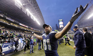 Photo - Seattle Seahawks' Golden Tate motions to fans as he leaves the field after the team beat the St. Louis Rams in an NFL football game, Sunday, Dec. 29, 2013, in Seattle. The Seahawks won 27-9. (AP Photo/Elaine Thompson)