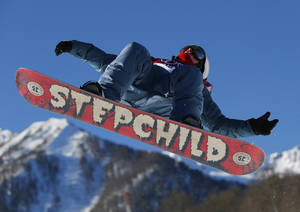 Photo - Russia's Alexey Sobolev takes a jump during men's snowboard slopestyle qualifying at the Rosa Khutor Extreme Park ahead of the 2014 Winter Olympics, Thursday, Feb. 6, 2014, in Krasnaya Polyana, Russia. (AP Photo/Sergei Grits)