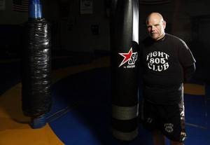 Photo - Mat Jones at the 805 Fight Club in Oklahoma City. Jones lost 260 pounds after having bariatric surgery and committing to a major lifestyle change. PHOTO BY SARAH PHIPPS, THE OKLAHOMAN <strong>SARAH PHIPPS - THE OKLAHOMAN</strong>