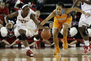 Photo - FILE - In this Jan. 5, 2014 file photo, Georgia guard Erika Ford, left, and Tennessee forward Cierra Burdick (11) chase down a loose ball in the first half of an NCAA college basketball game in Athens, Ga. Georgia has dropped out of the Top 25 after a 0-4 start in the SEC. (AP Photo/John Bazemore, File)